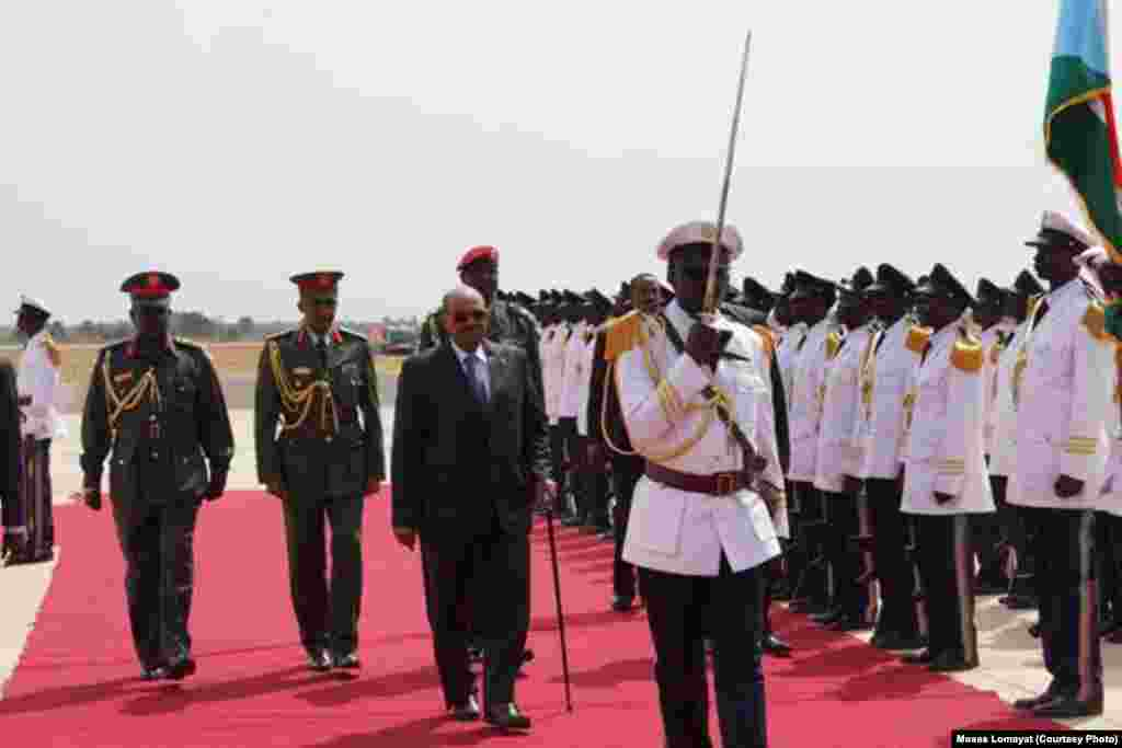 Sudanese President Omar al Bashir inspects an honor guard at Juba airport at the start of his first visit to South Sudan.