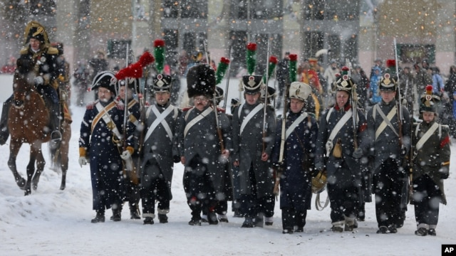 Historical re-enactors dressed as 1812-era French soldiers march during a re-enactment of the French Invasion of Russia during celebrations to mark the Russian Orthodox Christmas in St. Petersburg, Russia, January 7, 2013.