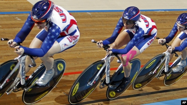 Team USA with Jennie Reed, Dotsie Bausch, and Sarah Hammer (L-R), competes to take a silver medal in the women's team pursuit final during the Track Cycling World Championships in Apeldoorn, Netherlands, March 24, 2011.