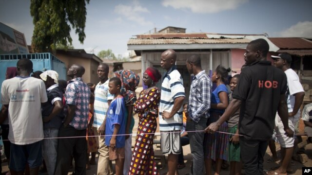 FILE -  People wait in line to vote at a polling station in Accra, Ghana, Dec. 8, 2012.