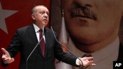 Turkey's President Recep Tayyip Erdogan addresses his ruling party members in Ankara, Turkey, Jan. 26, 2018.
