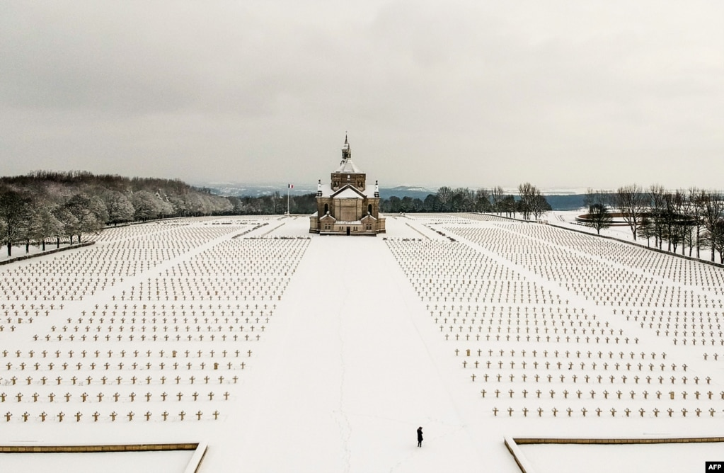 The Notre Dame de Lorette World War I military cemetery in Northern France is seen covered with snow.