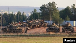 Turkish tanks positioned at a military base near the town of Suruc along the Syrian border, Sanliurfa province, Nov. 15, 2012.