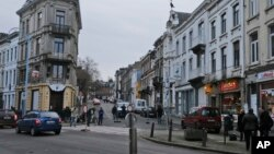 Belgian police officers guard a street in Verviers, Jan. 16, 2015.