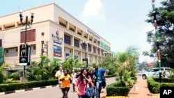 People run from the Westgate Mall in Nairobi, Kenya, Sept. 21 2013, after gunmen threw grenades and opened fire during an attack.