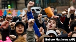 FILE - In New York's Foley Square, students protest against President Donald Trump's executive order banning travel from seven Muslim-majority nations.