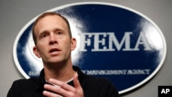 FILE - Federal Emergency Management Agency Administrator Brock Long speaks during a news conference in Washington, Aug. 31, 2017.