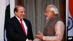 FILE - Indian Prime Minister Narendra Modi, right, shakes hand with his Pakistani counterpart Nawaz Sharif before the start of their meeting in New Delhi, India, May 27, 2014.