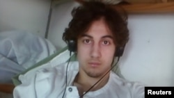 Dzhokhar Tsarnaev is pictured in this handout photo presented as evidence by the U.S. Attorney's Office in Boston, Massachusetts on March 23, 2015. Tsarnaev was heavily influenced by al Qaeda literature and lectures, some of which was found on his laptop,