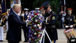 President Donald Trump participates in a wreath laying ceremony at Arlington National Cemetery, May 29, 2017, in Arlington, Virginia.
