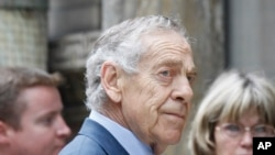 "FILE - ""60 Minutes"" correspondent Morley Safer arrives for Walter Cronkite's funeral at St. Bartholomew's Church on Park Avenue in New York, July 23, 2009. Safer died in May 2016."