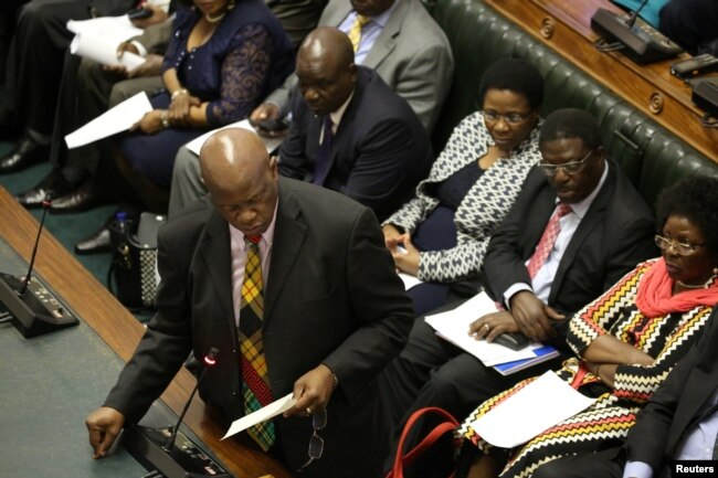 Patrick Chinamasa, Minister of Cybersecurity, speaks as members of Parliament gather to begin proceedings to impeach Zimbabwean President Robert Mugabe in Harare, Zimbabwe, Nov. 21, 2017.