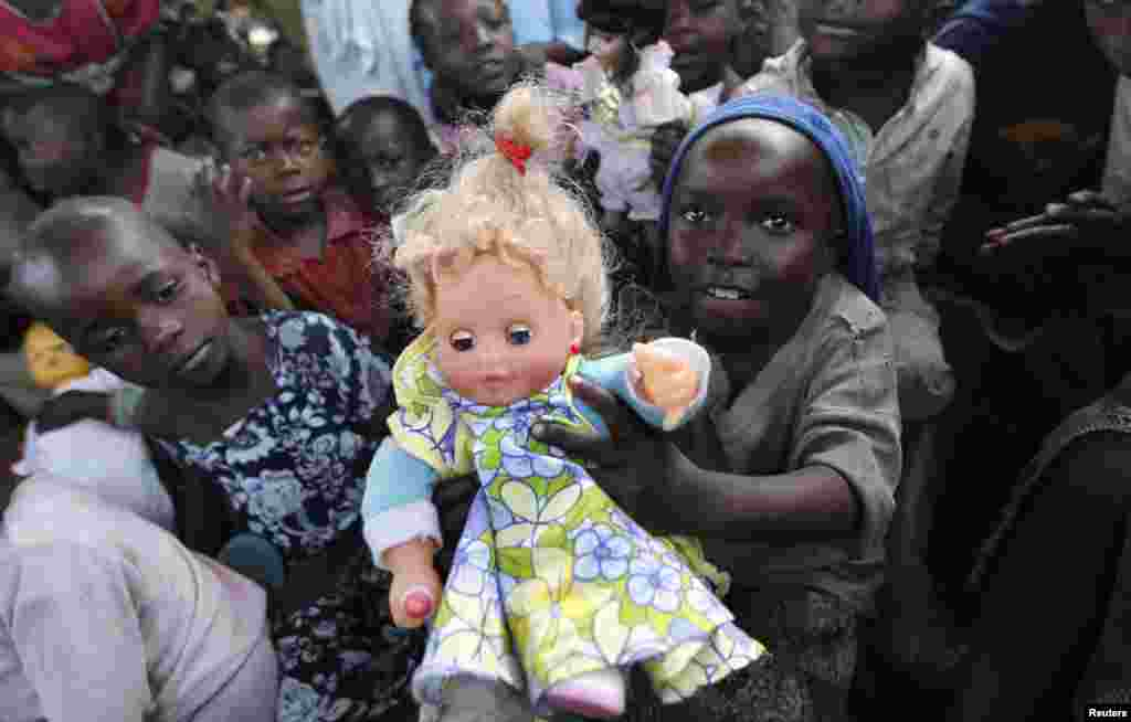 A Congolese girl, displaced by recent fighting in North Kivu, holds a doll at the child friendly space (CFS) within Mugunga III camp for the internally displaced people near Goma, eastern Democratic Republic of Congo.
