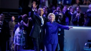 Democratic presidential nominee Hillary Clinton joins President Barack Obama after his speech at the Democratic National Convention, July 27, 2016.