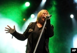 """FILE - This June 8, 2012 file photo shows Joe Elliott performing with the band Def Leppard at the after party for the """"Rock of Ages"""" premiere in Los Angeles."""