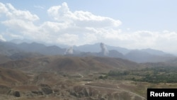 FILE - Smokes rises after а U.S. airstrike hits the site of insurgent activity in Nangarhar province, Afghanistan, July 7, 2018.