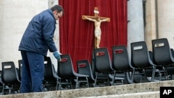 Workers install chairs in St. Peter's Square at the Vatican, March 18, 2013 for Pope Francis' Installation Mass on Tuesday.