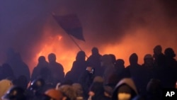 Protesters clash with police in central Kyiv, Ukraine, early Monday, Jan. 20, 2014.
