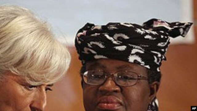 International Monetary Fund Managing Director Christine Lagarde, left, and Nigeria's Finance Minister Ngozi Okonjo-Iweala confer during roundtable meeting with Nigerian business executives in Lagos, Nigeria.