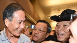 "Freed Vietnamese dissident Nguyen Van Hai (L) is greeted upon arrival at Los Angeles International Airport on October  21, 2014 in Los Angeles, California.  The Vietnamese blogger, also known by his pen name ""Dieu Cay,"" was handed a 12-year prison sentenc"
