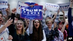 Supporters of Republican presidential candidate Donald Trump cheer during an early-morning campaign rally, November 8, Electon Day, in Michigan. (AP Photo/ Evan Vucci)