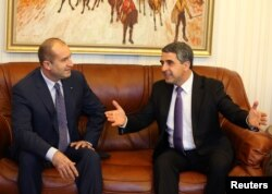 Bulgarian President Rosen Plevneliev, right, speaks to President-elect Rumen Radev in Sofia, Bulgaria, Nov. 14, 2016. Radev takes over in January.