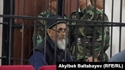 FILE - Azimzhan Askarov is seen in a courtroom, in Bishkek, Kyrgyzstan, Oct. 4, 2016. Askarov was convicted in 2010 for stirring up ethnic hatred and given a life sentence in a case that has drawn international criticism.
