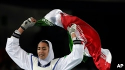 Kimia Alizadeh Zenoorin of Iran celebrates after winning the bronze medal in a women's Taekwondo 57-kgcompetition at the 2016 Summer Olympics in Rio de Janeiro, Brazil, Aug. 18, 2016.