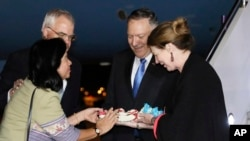 Secretary of State Mike Pompeo and his wife Susan are greeted with flowers by U.S. Embassy Chargé d'Affaires Peter Haymond and his wife Dusadee after they arrive in Bangkok, Thailand, Aug. 1, 2019.