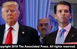 FILE - This Jan. 11, 2017, photo shows President-elect Donald Trump, left, his chief financial officer Allen Weisselberg, center, and his son Donald Trump Jr. during a news conference at Trump Tower in New York.