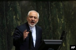 FILE - Iranian Foreign Minister Mohammad Javad Zarif, who is also Iran's top nuclear negotiator, addresses an open session of parliament in Tehran.