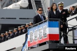 Taiwan President Tsai Ing-wen visits Panshi fast combat support ship during her trip at a navy base in Kaohsiung, Taiwan, March 21, 2017.