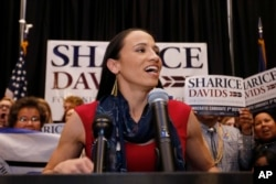 FILE - Democrat House candidate Sharice Davids speaks to supporters at a victory party in Olathe, Kan., Nov. 6, 2018.