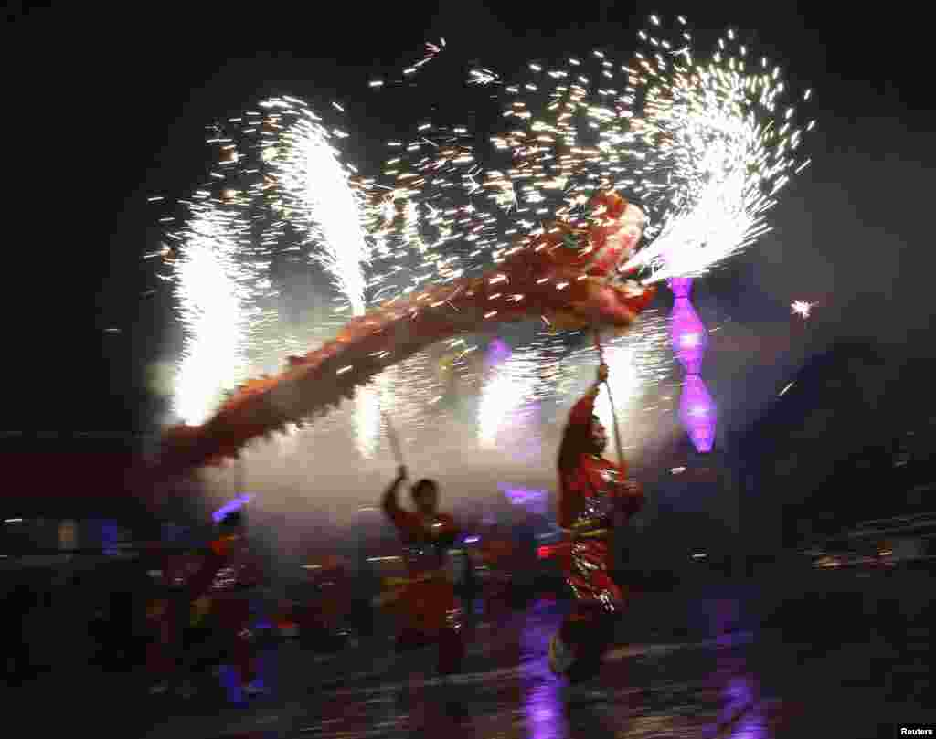 Dancers perform a fire dragon dance during a folk art performance celebrating the Chinese Lunar New Year, Beijing, China, Feb. 19, 2015.