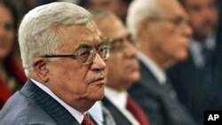 Palestinian President Mahmoud Abbas, left, attends the midnight Mass ceremony at the Church of the Nativity in the West Bank town of Bethlehem, 25 Dec 2010
