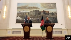 U.S. Defense Secretary Chuck Hagel left, and Afghan President Ashraf Ghani, right, speaks during a joint news conference in Kabul, Afghanistan, Saturday, Dec. 6, 2014.