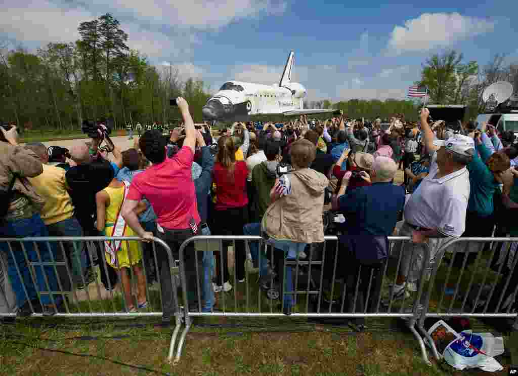 Space shuttle Discovery is rolled toward the transfer ceremony at the Steven F. Udvar-Hazy Center in Chantilly, Virginia, April 19, 2012. . (NASA/Carla Cioffi)