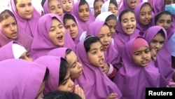 REUTERS - IRANIAN AND AFGHAN GIRLS AT EMAM HASAN MOJTABA SCHOOL IN KERMAN, IRAN