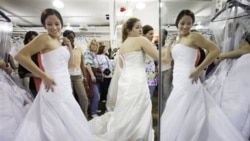 "Women shop for wedding dresses during the ""Running of the Brides"" at Filene's Basement in New York. The yearly event offers hundreds of bridal gowns at reduced prices."