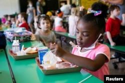 A student eats her school lunch at Wilder Elementary School in Louisville, Kentucky, August 11, 2021.
