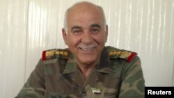 Former Syrian army commander, General Mustafa al-Sheikh, defected and wants to to lead rebel Free Syrian Army forces against Assad regime. (Reuters)