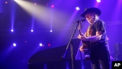 FILE - Willie Nelson performs at the iTunes Festival during the SXSW Music Festival in Austin, March 15, 2014.