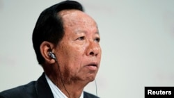 FILE - General Tea Banh, Cambodia's Defense Minister, waits for his turn to speak at 11th International Institute of Strategic Studies Asia Security Summit, in Singapore, June 2012.