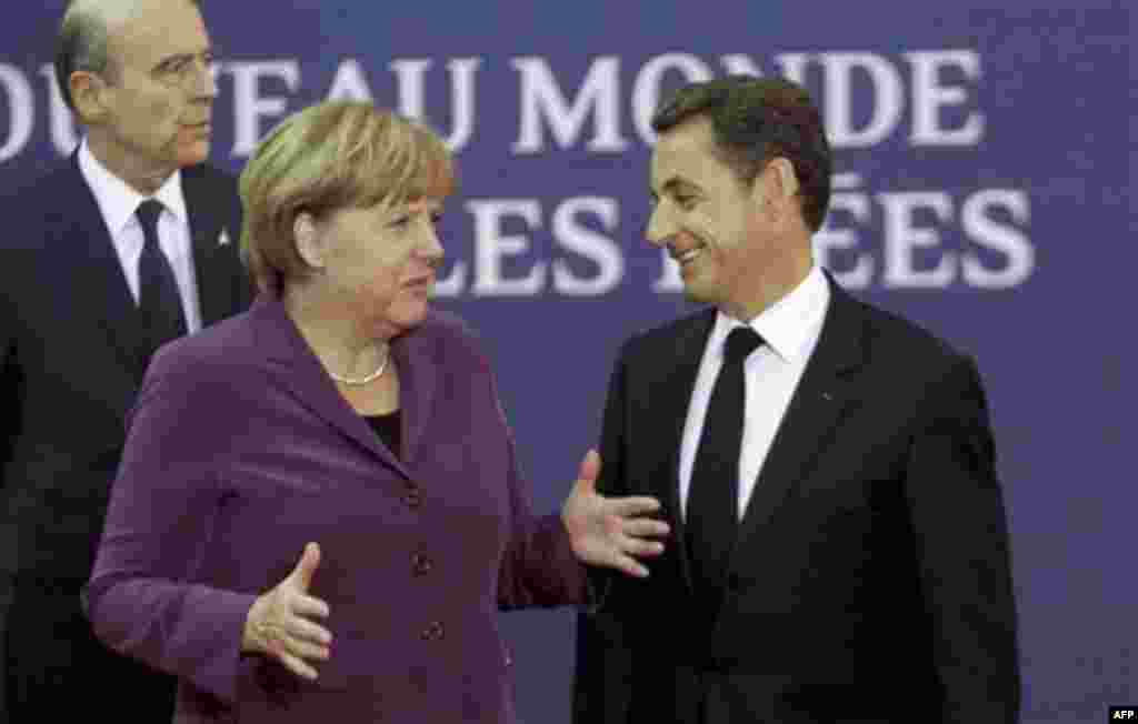 RETRANSMISSION TO IMPROVE TONING - French President Nicolas Sarkozy, right, speaks with German Chancellor Angela Merkel as they arrive for the G20 summit in Cannes, France on Wednesday, Nov. 2, 2011. Greek Prime Minister George Papandreou was flying to th