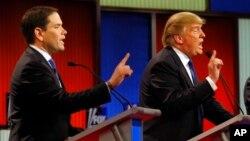 Ứng viên tổng thống của Đảng Cộng hòa Marco Rubio (trái) và Donald Trump tranh cãi trong một cuộc tranh luận trực tiếp hôm 3/3.