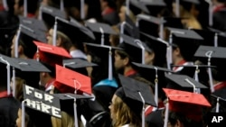 FILE - Students attend graduation ceremonies at the University of Alabama in Tuscaloosa, Alabama, Aug. 6, 2011.