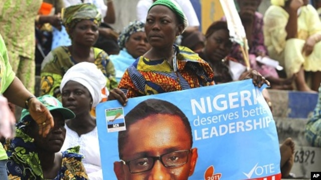 A supporter holds a poster campaigning for former anti-graft chief Nuhu Ribadu during the presidential primaries of ACN in Lagos, 14 Jan 2011