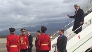 US Secretary of State John Kerry steps off his plane upon his arrival in Tirana, Albania, Feb. 14, 2016. (Pam Dockins/VOA)