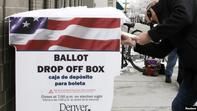 A voter participates in early balloting outside the Denver Elections Division in downtown Denver, Colorado on October 25, 2012.