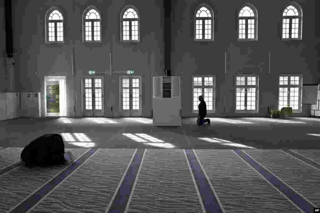 Muslim men pray in a mosque in Amsterdam, Netherlands.